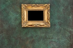Golden picture frame grungy wall bac