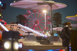 Ferris wheel behind the rides
