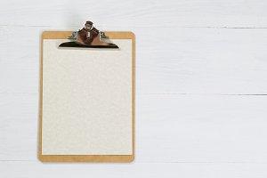 Clipboard on white desktop