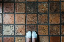 Standing on terracotta tiles by  in Abstract