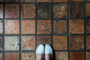 Standing on terracotta tiles