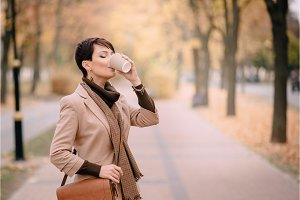 business woman drinking coffee in