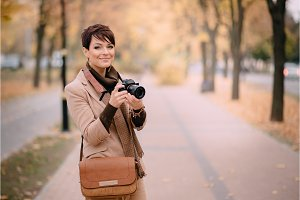 young female photographer looking at