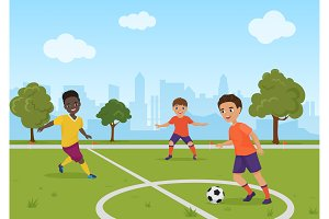 Boys playing soccer football