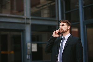 Businessman walking out of office