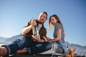 Beautiful couple having a picnic