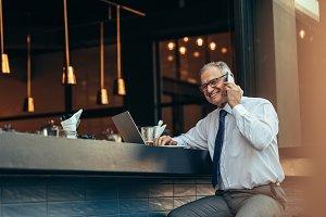Senior businessman at cafe
