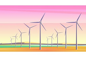 Windmills field with pink sunset sky