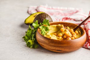 Avocado hummus in a wooden bowl