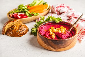Beet hummus in a wooden bowl