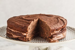 Vegan chocolate cake on a white dish