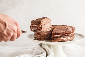 Vegan chocolate cake on a white dish