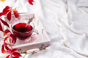 Hot healthy rose tea on wooden tray