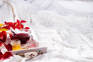 Hot healthy rose tea with honey on