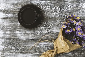 Cup of coffee ,flower wrapped in