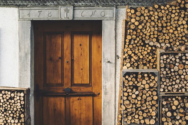 Architecture Stock Photos - Rustic door and firewood