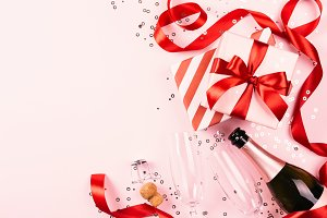 Christmas gifts on pink background.