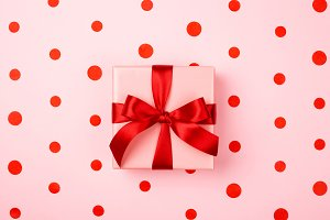 Gift box with red bow.