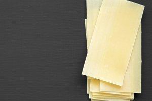 Lasagna sheets pasta on a black back