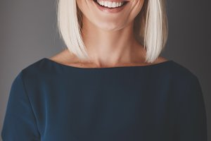 Smiling businesswoman using her cell