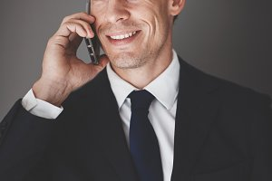 Smiling businessman talking on his c