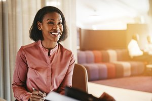 Smiling young businesswoman sitting