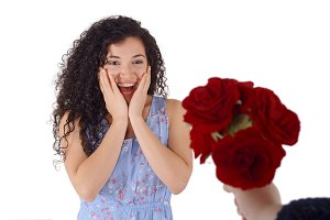 Surprised young woman receive bouque