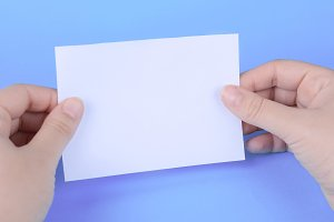 Woman hands holding empty note paper
