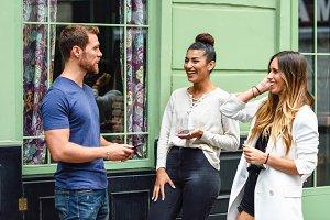 Three multiethnic people friends lau
