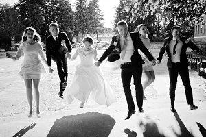 Happy wedding couple and bridesmids
