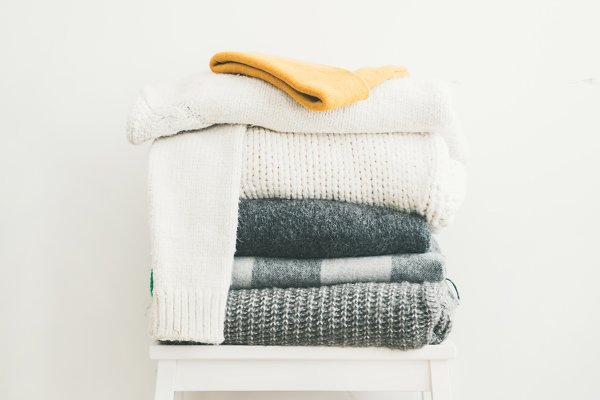 Pile of warm sweaters and blankets