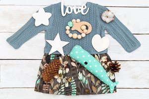 Baby girl clothes and wooden toys