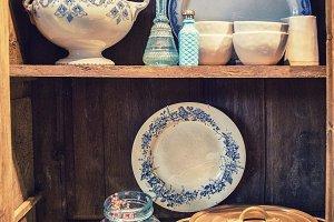 kitchen objects on wooden shelf