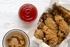 Delicious chicken wings with ketchup