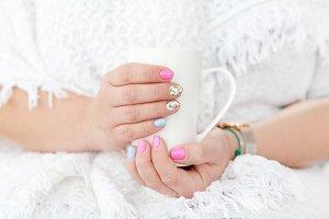 Female hands holding a mug