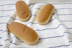 Hot dog buns on striped napkin