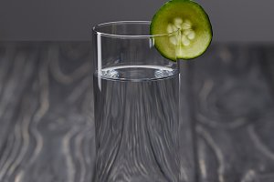 glass of water with piece of cucumbe