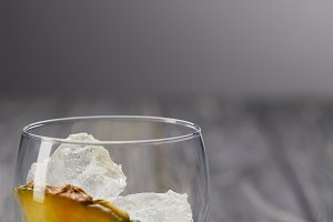 glass with ice cubes and piece of pi