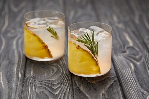 two glasses of lemonade with pineapp