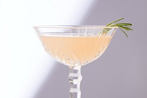 alcohol cocktail in glass with rosem