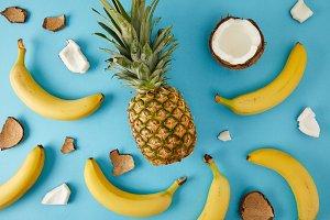 flat lay with fresh pineapple, banan
