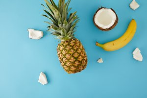 flat lay with ripe pineapple, banana