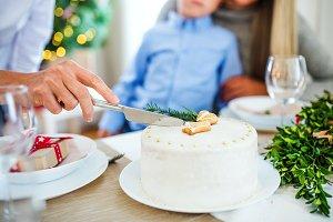 Unrecognizable woman cutting a cake