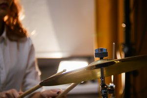 Repetition. Ginger girl plays drums