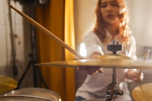 Repetition. Redhead girl drummer
