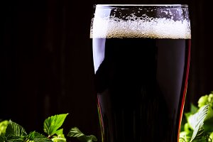 Dark english beer, ale or stout is p