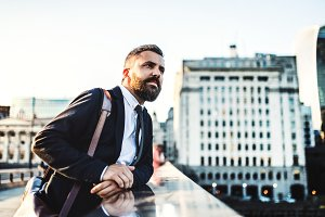A hipster businessman standing on a