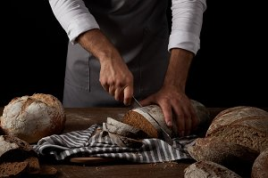 partial view of male baker in apron
