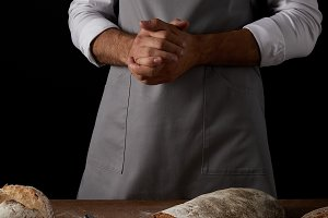 cropped shot of male baker in apron