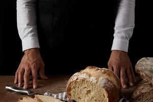 cropped image of male baker in apron